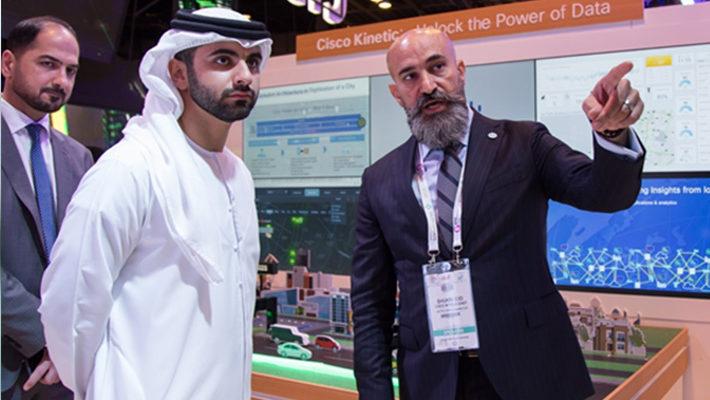 Shukri Eid, Managing Director – East Region, Cisco Middle East presents to HH Sheikh Mansoor bin Mohammed bin Rashid Al Maktoum at Cisco's GITEX stand